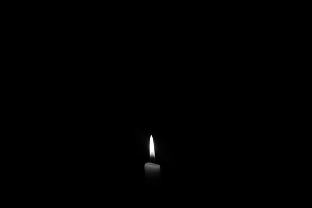 darkness with a candle